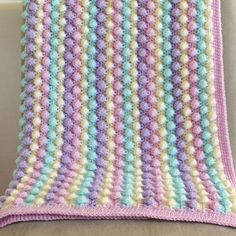 Crochet bobble blanket in Cream, Sherbet, Wisteria and Clematis Stylecraft acrylic yarn. Measures approximately 32 inch square. Crochet baby blanket - easy, quick and pretty! No pattern but does have a chart and it doesn& look to hard. Crochet Crafts, Crochet Yarn, Crochet Stitches, Crochet Projects, Diy Crafts, Crochet Bobble Blanket, Crochet Blanket Patterns, Knitting Patterns, Fleurs Diy