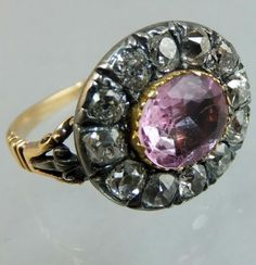English ca 1760 gold and silver ring with a pink topaz in the middle and diamonds around.