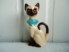 "Vintage Siamese Cat Figurine...reminds me of Grandma Parkin.  She always had a Siamese cat and always named them ""Kimi.""   ....Pat"