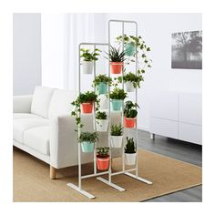 "IKEA SOCKER plant stand If possible hang on kitchen ""wall"". Can spray pots and holders the same colour"