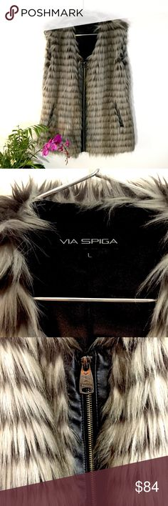 Via Spiga Faux Fur Vest Via Spiga Faux Fur Vest.  This one is killing me to let go!  Absolutely awesome with the Via Spiga Leather boots in my closet!  It was my favorite over two dresses a black rag and bone and a navy and black Madewell Shift.  Both will be posted shortly!  It's in fantastic shape.  Size L Via Spiga Jackets & Coats Vests