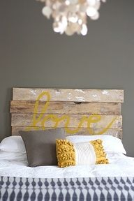 wood headboard... maybe with white words against my yellow wall? love the gray pillow too.