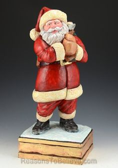 All Aboard - 14 inch tall hand carved, wooden Santa with toy bag by Joseph Land.