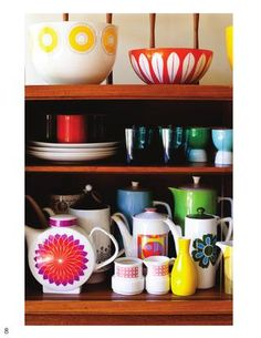 Collect vintage ceramics to make a lovely display like this and add colour to any room - these have a bright 60's feel, or go with more muted 40's/50's teasets for a subtle finish.