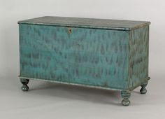"""Pennsylvania painted pine blanket chest, 19th c., retaining its original blue smoke decorated surface, 25 3/4"""" h., 42"""" w."""