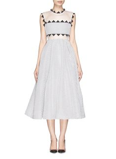 Ergonomically designed for an eccentric London flavour, self-portrait renders this dress in contrasting mesh upon jacquard for a truly tactile finish. Paved with quirky triangular pleated grosgrain at the bodice, this number can make an outlandish statement for occasions day or night.