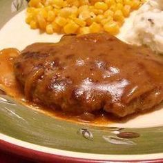 an easy to make classic featuring tasty hamburger 'steaks' smothered in gravy and onions. it's a great way to dress up a pound of ground beef and you probably have all the ingredients on hand!