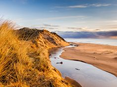 Balmedie Beach at Sunrise - My parents house is near the beach. The weekend I was staying there I got a lovely sunrise with the first light hitting the Sand Dunes.