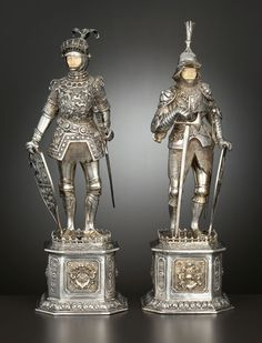 A PAIR OF GERMAN SILVER AND SILVER GILT FIGURAL KNIGHTS WITH IVORY FACES. Maker unknown, Germany, circa 1920.