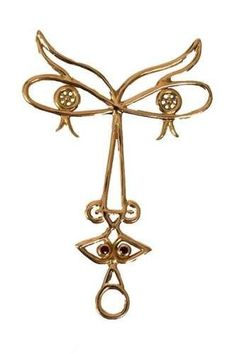 Madame, a gold pendant necklace with rubies and diamonds by Jean Cocteau