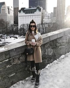 NYFW Round up via For All Things Lovely | staying cozy in Central Park in Club Monaco coat, Project Social top, Revolve leggings, Sorel boots and Chanel handbag | New York City, New York