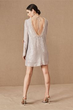 Allover sequins bring substantial sparkle to this open-backed mini dress. Ruffled accents at the neckline and sleeves complete the look. Holiday Party Dresses, Holiday Parties, Bhldn, Needle And Thread, Anthropologie, Cold Shoulder Dress, White Dress, Sequins, Stylists