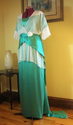 Replica of late 1913 French evening, reception, or dinner gown, made as described in the original French text -- emerald green silk satin, off-white silk chiffon, and hand-beading (I used the original antique beading design).    Underlined in light emerald fine China silk, ivory taffeta silk boned under-bodice, off-white China silk lining to around knee length.  Made for the ROM's 100th anniversary.  See my website: www.thefashionarchaeologist.com for more information on what I do.