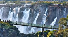 Zambia's Knife Edge Bridge, a narrow pedestrian bridge above a gorge with spectacular views of Victoria Falls. Waterfall Photo, Pedestrian Bridge, Victoria Falls, The Weather Channel, Slovenia, Natural Wonders, Taking Pictures, Vacation Spots, South Africa