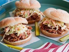 Fall-Apart Pulled Pork Barbecue  -  Recipe courtesy of  Tyler Florence When given Tyler's treatment — i.e., roasted low and slow in the oven with a spicy-sweet dry rub — an otherwise tough cut of meat becomes tender enough to pull apart with a fork. Piled over a plush bun with creamy coleslaw and tangy cider vinegar barbecue sauce, it becomes the ultimate pulled pork sandwich.