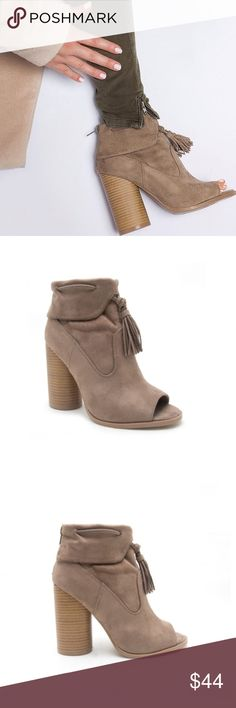 ✨COMING SOON✨ NWT. Taupe heeled boot ✨COMING SOON✨ NWT. Taupe heeled boot. Back zipper, fringe tassel. Comes in the original box. True to size. LIKE THIS LISTING TO BE NOTIFIED WHEN IT COMES IN STOCK. (Comment your size to reserve a pair) Shoes Ankle Boots & Booties