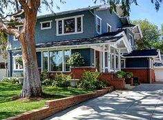 Old Craftsman House in Pasadena remodeled with blue siding. My red brick house's addition has wood siding painted brown. Wonder how this blue would look with my brick house?