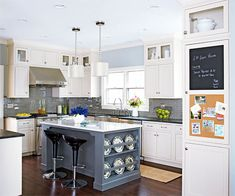 Coordinated Charm Like materials and a relaxed color palette unify this updated kitchen and its neighboring breakfast room. Light Shaker-style cabinets are grounded by dark granite perimeter countertops; on the marble-topped island, the color palette is reversed to create a beautiful, contrasting look