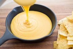 This is the BEST Homemade Nacho Cheese Sauce! Made with only five all-natural ingredients (trust me, it doesn't need more), and takes 10 minutes to make. Perfect for football snacking.