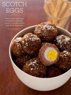 Our recipe for Scotch Eggs is a great appetizer. Scotch Eggs are hoard boiled eggs wrapped in sausage, coated in breadcrumbs, then fried. Quail Recipes, Egg Wrap, Breakfast Desayunos, Gula, Quail Eggs, English Food, Appetizer Recipes, Bacon Appetizers, Brunch Recipes