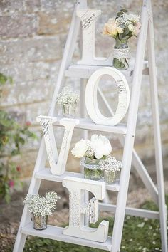 Use a ladder to create a pretty decorative centre piece at the reception. [Photo: Pinterest]