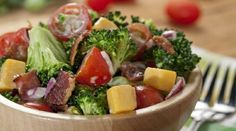 broccoli bacon salad with cheese and tomatoes