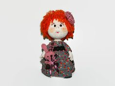My name is Sola and I'm a handmade crochet doll. I'm about 21 cm tall, I have a fair complexion, hand painted marks under my eyes, and my hair is needle felted out of sheep wool.I am stuffed with polyestre stuffing.