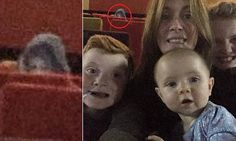 Family 'photobombed by ghost' in cinema selfie