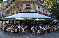 10 Great Spots in Paris with a Literary History | Fodors at Les Deux Magots  drinking coffee