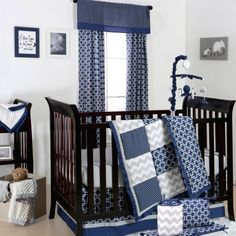 The Peanut Shell 5 Piece Baby Boy Crib Bedding Set - Navy Blue Geometric and Grey Zig Zag Patchwork - 100% Cotton Quilt, Bumper, Dust Ruffle, Fitted Sheet, and Mobile  Unfortunately, the ugly mobile is included, but not the nice drapes. Wal-Mart