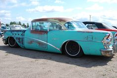 patina-painted and airbagged 57 Buick