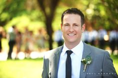 You can't go wrong with a grey suit. Luxury Wedding Photography by photographer Paul Barnett.