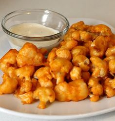 Buffalo Cauliflower. friends, this was SO good! i made this today (8-20-13) with half a cauliflower and wish I had used the whole thing. we didn't even use a dipping sauce. make it and eat now!