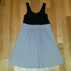 Bebe twofer dress Twofer dress from bebe. Black cotton/spandex top, blue seersucker skirt. Skirt is lined. Pockets at the sides. Side zip closure. bebe Dresses