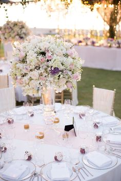 Pink and purple floral centerpiece for this luxurious destination wedding // Plush Phuket Wedding Which Ended in an Explosion of Fireworks: Aston and Victoria