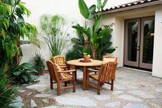 courtyard decorating with tropical plants and wooden furniture : Courtyard Decorating Ideas. courtyard decor ideas,decorating a courtyard,decorating courtyard homes,decorating your courtyard,make courtyard decorating Canopy Outdoor, Outdoor Rooms, Outdoor Living, Outdoor Furniture Sets, Outdoor Decor, Outdoor Areas, Porches, Bistro Patio Set, Spanish Courtyard