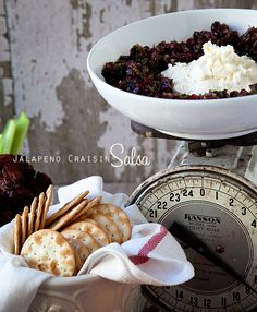 Jalapeño Craisin Salsa served over cream cheese. Sounds interesting...jalapenos, onion, orange juice, cilantro, honey, lime, and dried cranberries. The blogger who shared this recipe says it becomes the star of the show.