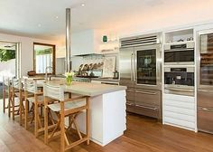 "Pamela Anderson's Malibu Beach House  Kitchen.  All the goodies:  Sub-Zero Pro 48 Fridge, Miele Coffee Maker w/ Cup Warmer, Miele Speed Oven, Sub-Zero Wine Fridge, Thermador 48"" range. Hooked On House blog"