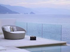 I think once I sat in that chair I'd never leave! This looks so serene...   (Casa Almare in Puerto Vallarta, Mexico) #design #architecture #contemporary #modern #chair #ocean #beach