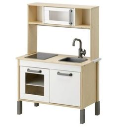 Duktig Mini-Kitchen - $99.99 »  May I introduce you to my favorite modern, well-priced play kitchen? And it comes for under $100! The stove even lights up with the addition of a few batteries. It's a real keeper.