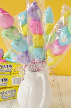 Peeps on a Stick - So I picked up a few boxes of Peeps – one in every color and used some long lollipop sticks I already had at home.  You can usually find the sticks at the craft store or a cake/candy decorating store.    I just skewered the poor little things with the lollipop stick (you could also use bamboo skewers which may be easier to find) and I had Peeps on a Stick!