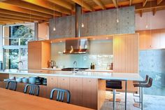 Amazing Modern Home With Kitchen. In The Dining Area, Emeco Navy Chairs Tuck Into A  Custom Fir Table With Metal Legs. Lapalma Thin Bar Stools Offer Extra  Seating ...