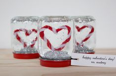 Snow Globe Valentines - Sweet...pipe cleaners twisted into a heart and inside a little mini snow globe. Use recycled baby food jars. Adorable.