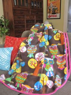 DIY Fleece Blanket: How to sew bias tape around a fleece blanket. (The owls are cute too)