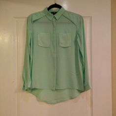 Mint color blouse Worn once, mint color blouse from HM, size 4 =XS. Gold studs on pockets. Gold color buttons on sleeve placket. Great for layering. H&M Tops Blouses