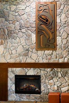 would love the whale and salmon piece above the oven like this over a fireplace. gorgeous.