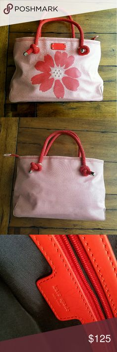 """Vintage KSNY Flower Bag Beautiful Vintage Red  Kate Spade Flower Purse. 100% Authentic. Signs of wear, but no major flaws. 14""""?5""""?9"""". Navy interior. 1 inside zipper pocket 2 open interior pockets. Zip closure for top of bag. Only flaw is little bleach spot under bag. Not seen when worn. 4 silver studs on bottom. Absolute gem of a purse! kate spade Bags"""
