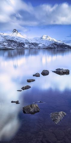 ~~Stac Pollaidgh In Scotland ~ fabulous blue reflections in the perfectly still water makes a dramatic image of winter mountains in the background standout by Lynne Douglas~~