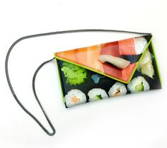 """Go Global This Shopping Season: For the fashionista—for the lady who always arrives to lunch looking perfectly poised, we present the sushi purse. Digitally printed on canvas, each purse is handcrafted and signed by the artist Kent Stetson. Kent believes """"that a great handbag can engage people in the same way as art."""" Each bag is fully lined and can be worn as a clutch or shoulder bag. $165"""