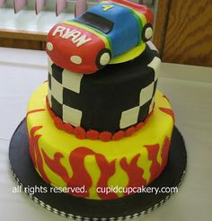 Grooms cake idea. Maybe camo instead of flames  Rainbow Race Car Cake by Cupid Cupcakery, via Flickr